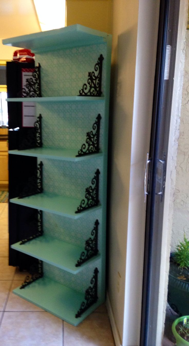 My DIY shelf in my kitchen. Stenciled the back, brackets are from hobby lobby. The light turquoise paint is latex that I used and created my own chalkboard paint.