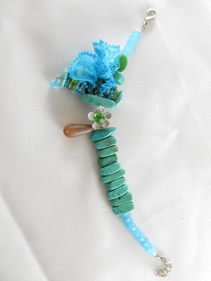 Handmade lace bracelet (1 pc)  Made with handmade bead with fiber and glass beads, metal flower, lace, semiprecious stones and glass beads.