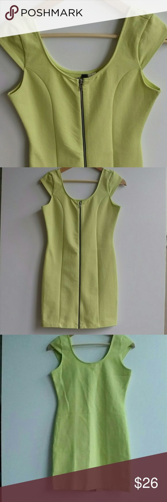 "Divided H&M Bodycon Dress Green, Zip Front - Sz 8 Divided by H&M dress, neon Green/yellow with a zip closure in the front and cap sleeves. Size 8. Dress is fitted and made from 72% cotton, 24% polyamide, 4% elastane. Perfect dress for your upcoming vacation to the beach! Lay flat measurements: Chest: 31"" Length:29.75"" Shoulders: 11.5"" Waist:26' Please reach out if you have any additional questions! :) Divided Dresses Mini"