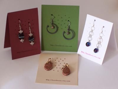 simple earring hang tags; only problem is that some of ours are too big to comfortably hang like that.