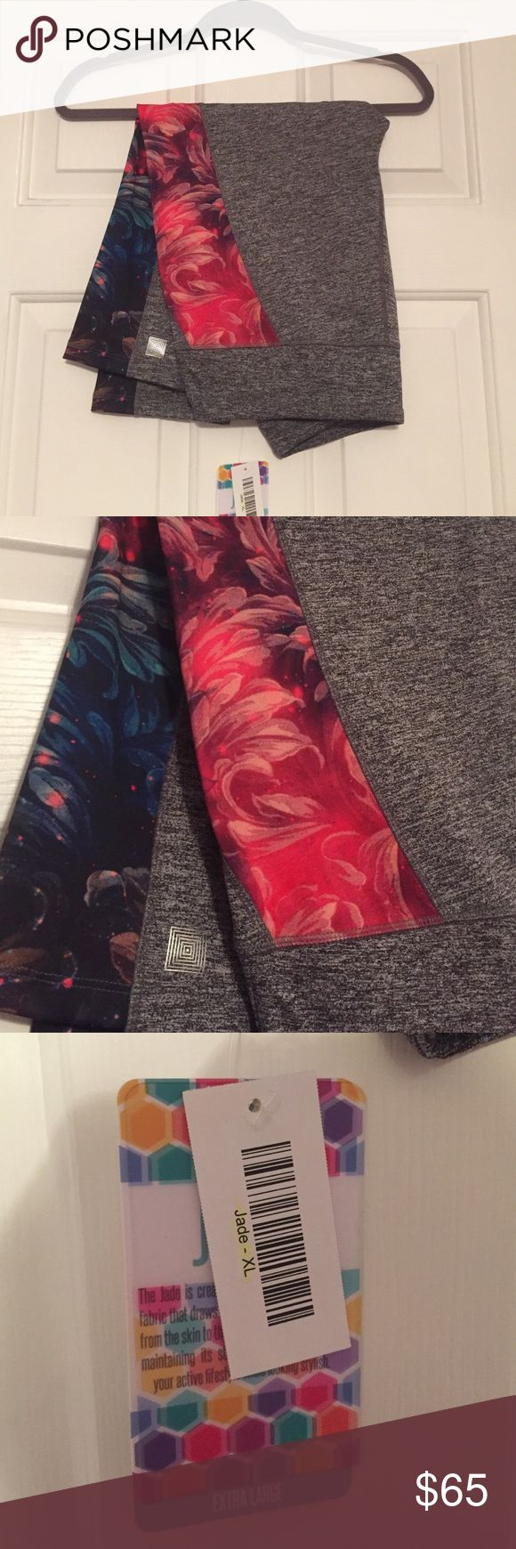 NWT Lularoe Jade Workout Capri Leggings NWT Lularoe Jade Workout Capri Leggings, Size XL, medium gray leggings with a pink, purple, and blue floral pattern on outer thigh. Extra soft and stretchy and brand new!! **Prices are firm unless you bundle and no trades, thank you!** LuLaRoe Pants Leggings