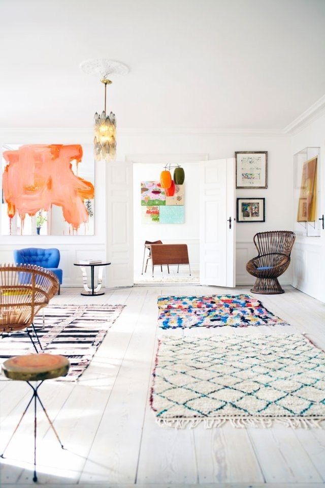 A Danish apartment with magical style, featuring my favorite mix! Beni Ourain and Boucherouite rugs. The Beni Ouarain in this room does such an amazing job of creating lines of interest in the room, while the Boucherouite rugs add the happy! http://www.etsy.com/shop/bringyourownsunshine