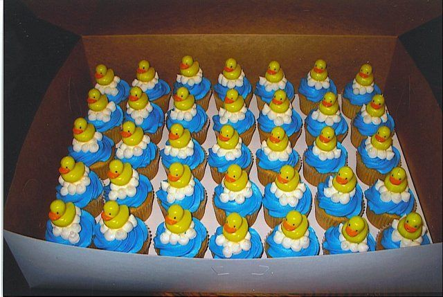 Baby shower cuppies - These were cupcakes that I had done for a recent baby shower.  The theme was rubber ducks.  I had displayed them on a cupcake tree with a six inch cake on top with a bigger rubber duck as the topper (not pictured).  I had a blast with these and everyone loved them.