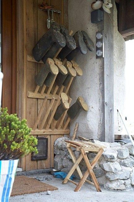 A homemade gumboot stand by the back door keeps the doorway clear and makes sure boots don't go missing