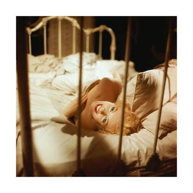 Milton H. Greene captures a famous color photo of Marilyn Monroe in her classic 1956 movie of Bus Stop. Marilyn Monroe is seen in bed laying on her...
