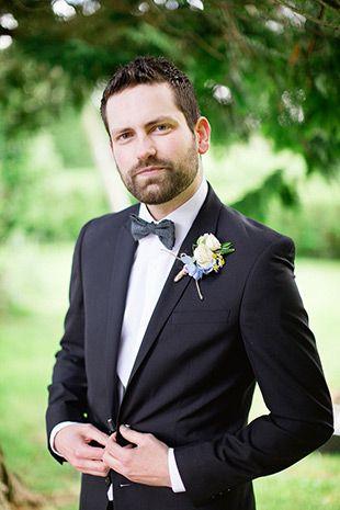 Dapper navy suit and bowtie groom style   onefabday.com