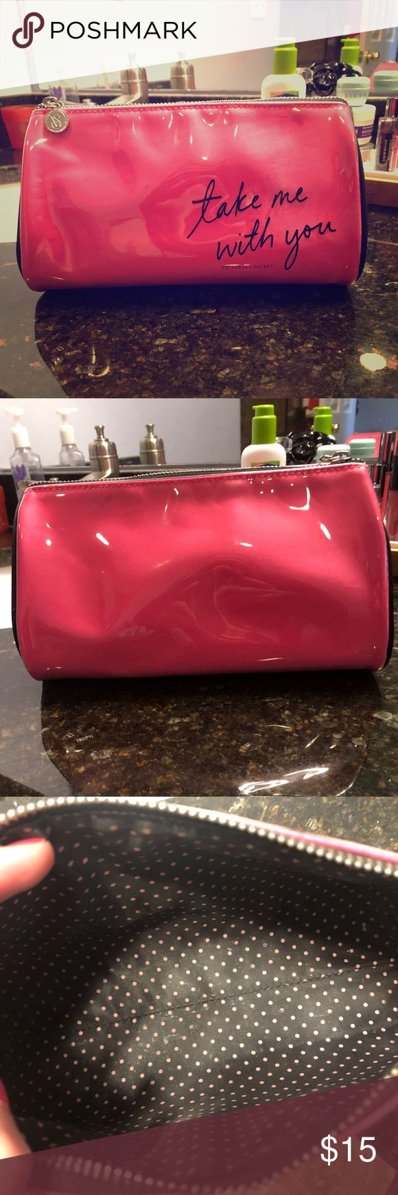 """Victoria Secret Plastic Coated Cosmetics Bag Pre-loved, EUC, makeup bag from VS. Bright pink color, black piping around the outside rim. Inside lining is black with pink polka dots. """"Take Me with You"""" is written in black on front. The outside is covered in clear plastic. The entire bag inside and out has been wiped clean. Zip top, can fit tons of makeup essentials including a larger size palette.  Measures: 9"""" across 5.5"""" from top to bottom, top opening measures 6"""".  Smoke free home. This is…"""