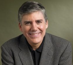 """Rick Riordan. His last name is pronounced """"RYE-r-don."""" Author of """"Percy Jackson & the Olympians"""" book series. Born: 1964. Country Born: America"""