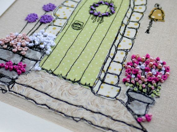 I love making freehand embroidery pictures and this one shows a beautiful stone cottage front door with a very welcoming display of flowers. The design is sketched first then fabric cut to create the shading and background. I have used high quality cotton fabric by Makower UK for this design in shades to compliment the stone work and painted door. The background is a natural linen. The detail is added using free-motion machine embroidery to draw the picture with stitches. Every brick, door…