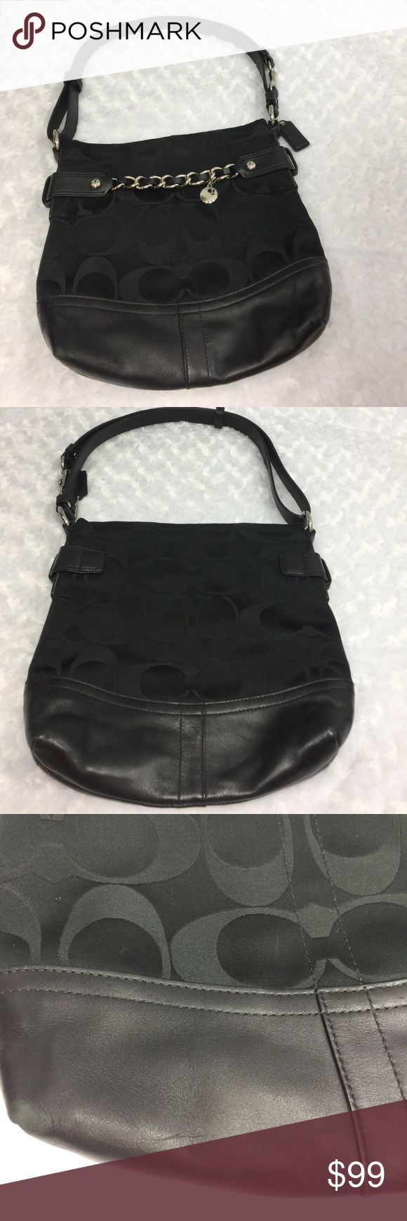 """Black signature Coach Purse Shoulder or CrossBody Very nice black on black signature coach purse. Trimmed with black leather and silver chain. Strap converts from shoulder to cross body. Purse measures 12"""" wide, 10.5"""" tall. I've only used a couple of times. The inside is very clean. The outside is pretty much flawless except for one surface scratch at the bottom of the bag as pictured. Non-smoker. comes with a coach storage bag which I have stored it in. Coach Bags Shoulder Bags"""