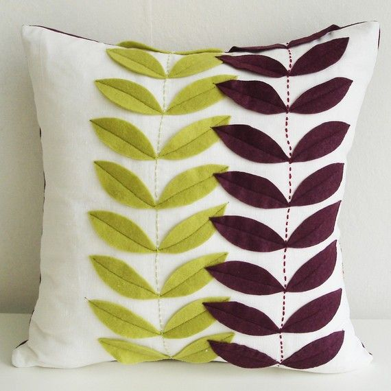 This doesn't look too hard to do. Cut the leaves out of felt and stitch them on the pillow before inserting your pillow form.