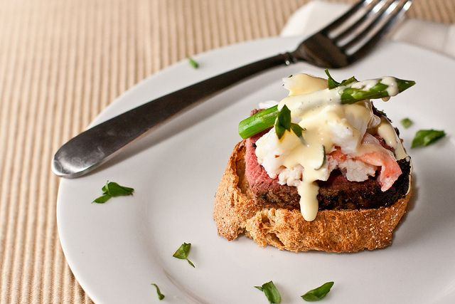 ... steak topped with crab meat, asparagus tips, and Bearnaise sauce
