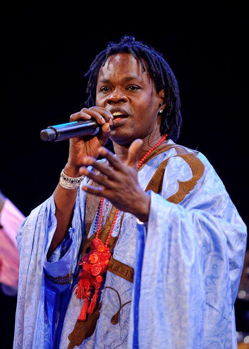 Baaba Maal - Senegalese Singer and guitarist. Book - Coups de Pilon by David Diop. Luxury - Guitar. 15-3-2009.