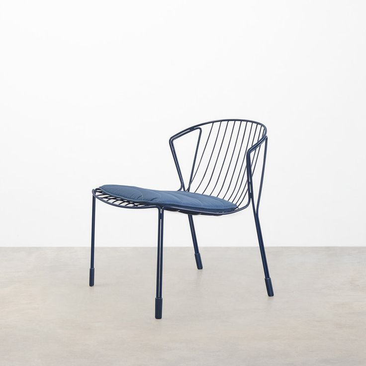 The Tidal lounge chair. Seen here in in blue with matching cushion. Part of the new Tidal Collection designed by Trent Jansen for Tait.