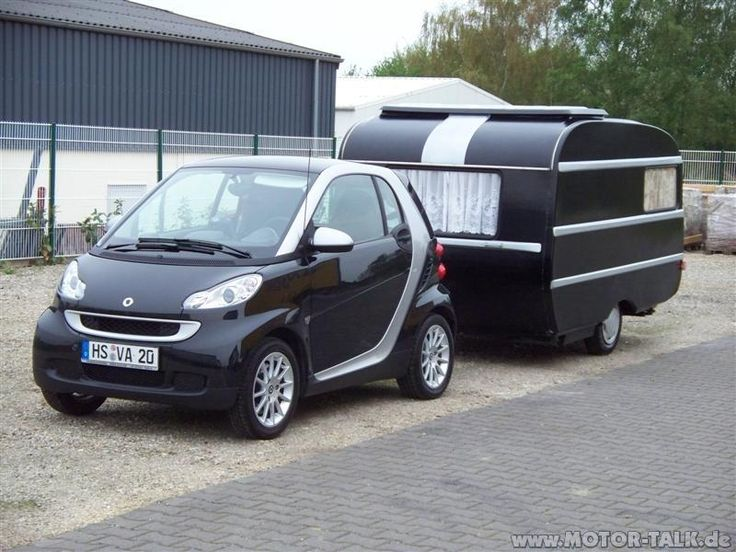 look at that...a smart pulling a bitty camper....perfect