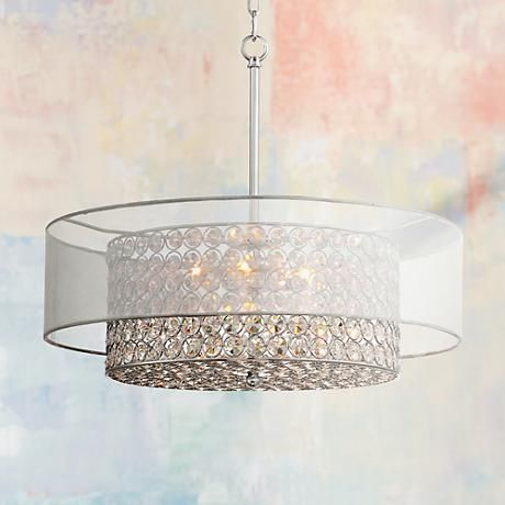 This tasteful double shade pendant light offers radiant crystal and stylish organza accenting.