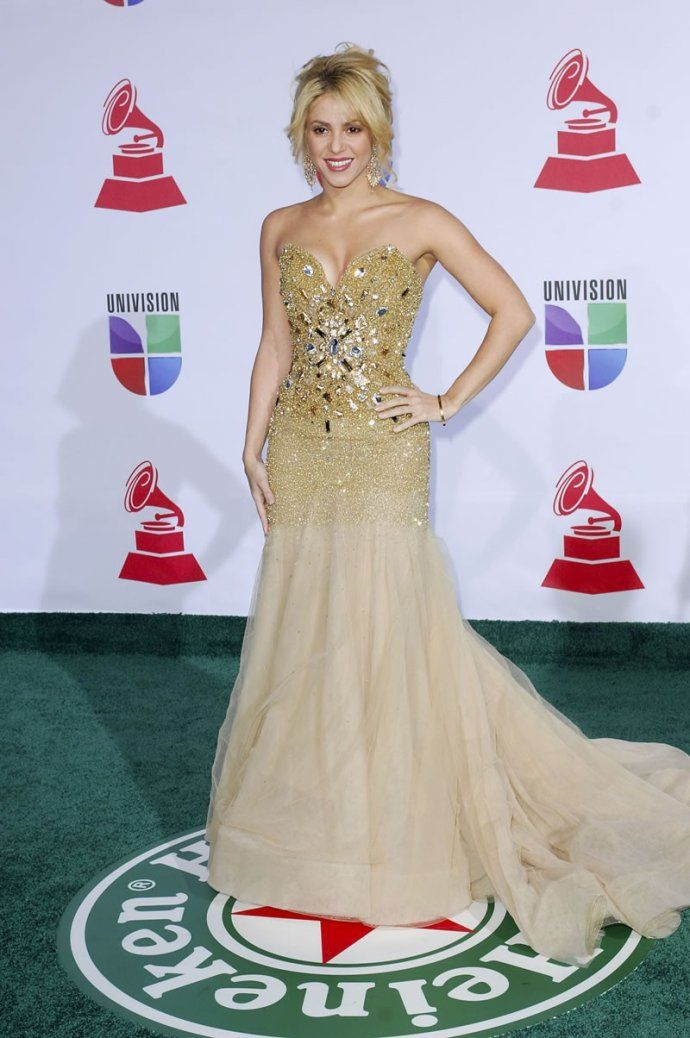Shakira was a golden goddess in a golden gown which matched so well with her hairs on the 2001 Grammy red carpet