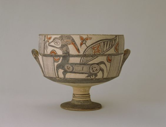 Cypriot kylix, Bichrome IV period  7th century B.C. The scene represents a winged he-goat sniffing a bird-flower, representations are full of humour and spirit in keeping with the Cypriot character of the period. The artist has given a certain free rein to his imagination for his painted decoration is light and airy and his goats have flowers with birds' eyes either growing out of or appearing from behind their wings, 15.5 cm high. George Ortiz collection