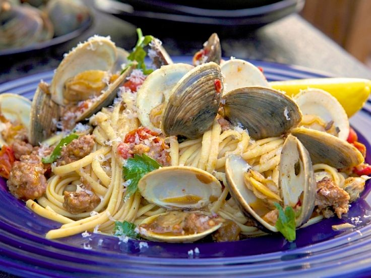 Pasta with Clams, White Wine and Spicy Italian Sausage recipe from Guy Fieri via Food Network