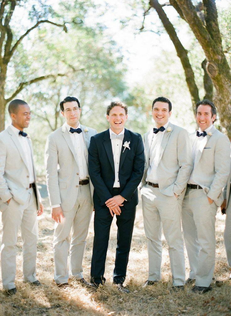groomsmen in tan suits and groom in black via style me ...