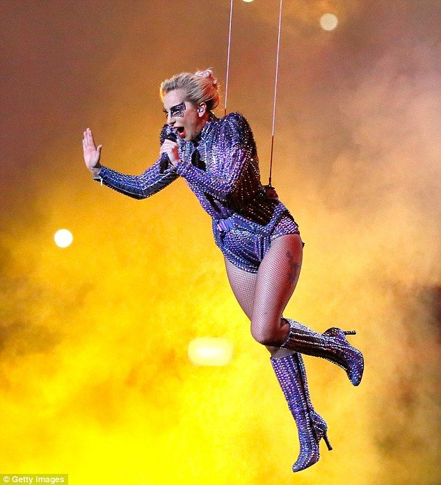 High-wire act: Gaga put on quite a show as she descended from the NRG Stadium in Houston, Texas while held up by support wires