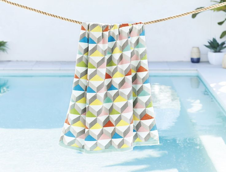 The Morgan & Finch Cato beach towel is the perfect summer companion. Made from combed cotton which has been woven and sheared to produce the softest velour, this luxurious and contemporary beach towel is lightweight and easy to carry.