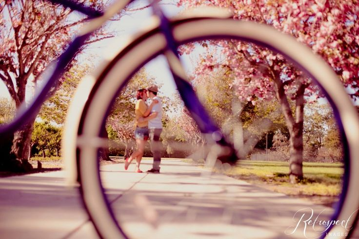 vintage engagement photo photography retro couple bicycle bike cherry blossoms spring love