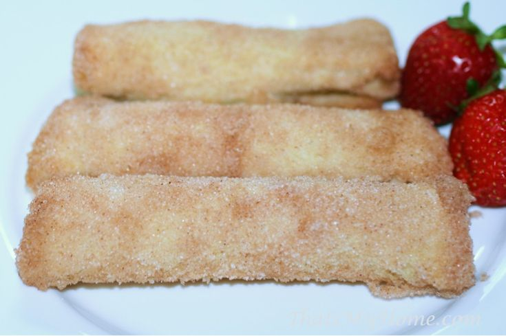 Crack Sticks are bread stuffed with a cream cheese filling and rolled in butter and cinnamon sugar before baking. Yum!