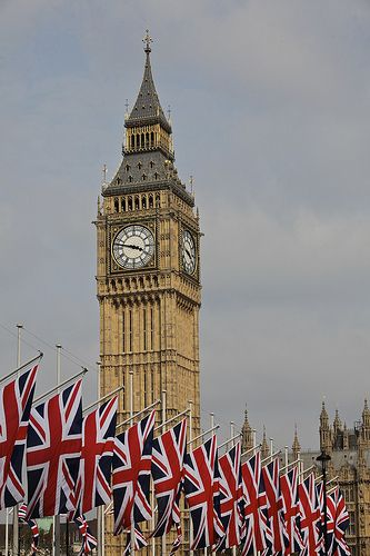 Big Ben standing proudly over a row of Flags of Great Britain. (aka Union Jacks)