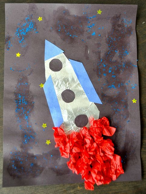 Cute rocket ship craft from aluminum foil, tissue paper, construction paper and glitter.