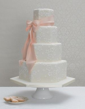 http://www.thecakeparlour.com/wp-content/uploads/2011/01/Bow-and-Blossom-wedding-cake-300x384.jpg