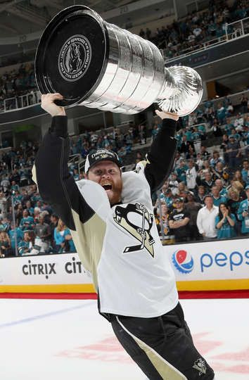 - JUNE 12: Phil Kessel #81 of the Pittsburgh Penguins lifts the Stanley Cup…