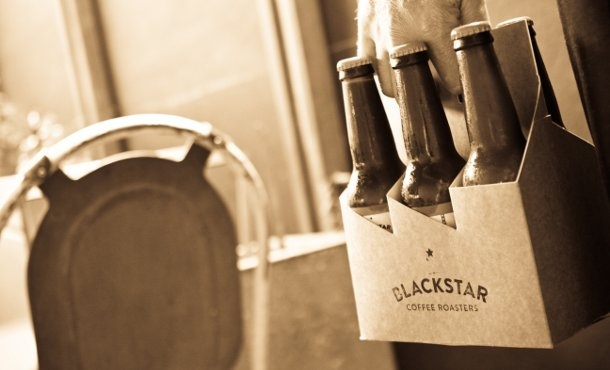 stamped plain cardboard six pack of cold pressed coffee in beer bottles (blackstar and bunker)