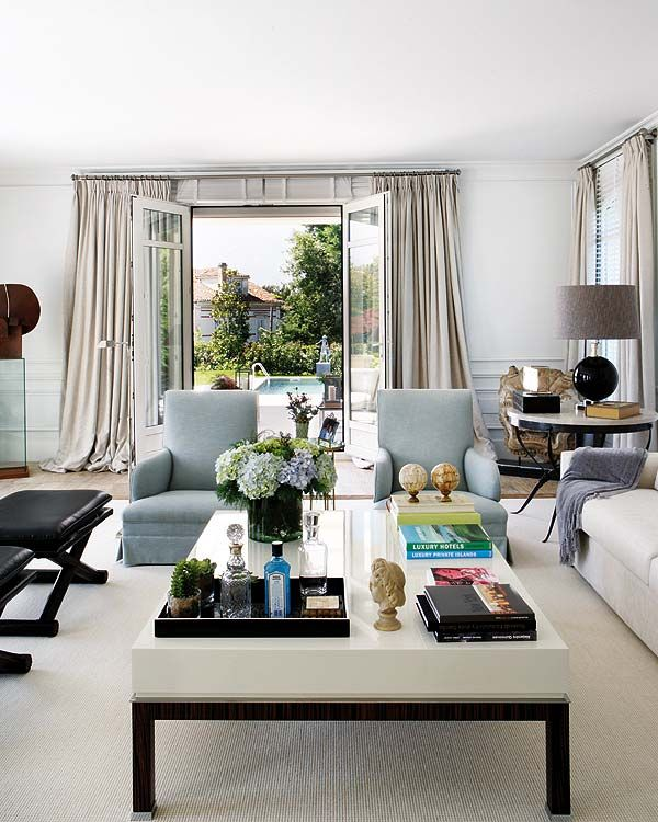 luxuriate in the living room coffee table styling beautiful living room with cool blue while with black accents