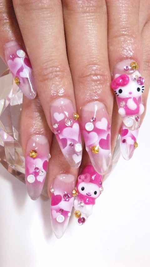 i wouldnt do the stiletto nails, but the hello kitty is perfect! :D