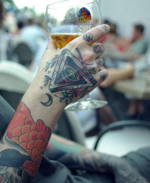 Digging this hand tattoo - and notice the tasty Leffe beer representing Belgium