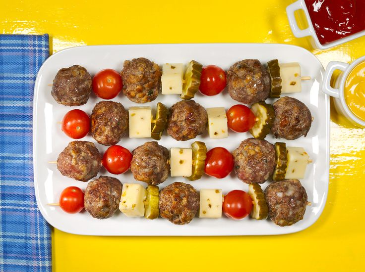 Cheeseburger Meatball Kabobs – When you have Easy Basic Meatballs prepared, this simple recipe can be dinner table-ready in just 15 minutes flat! #PinThatTwist