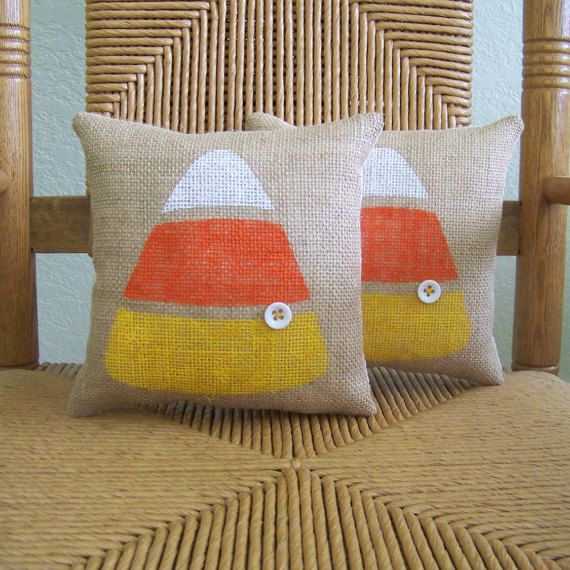 Made from burlap fabric hand stenciled in white,orange and yellow fabric paint with a white button accent. It is lined in muslin and has a