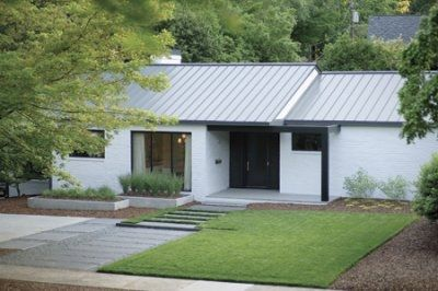 lil white ranch with metal roof and black trim take it outside