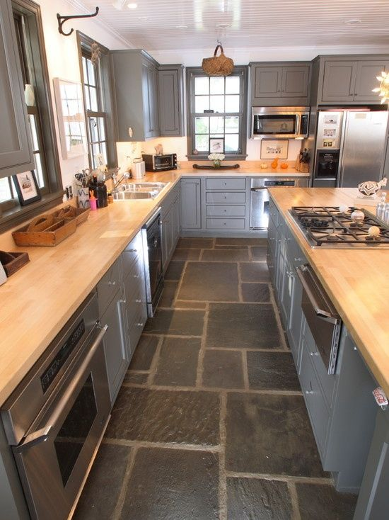 High gloss cabinets contrast with slate floor