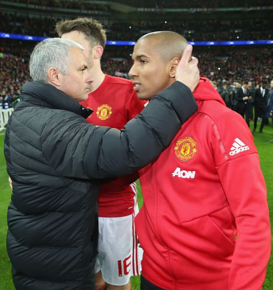 Ashley Young and Manager Jose Mourinho of Manchester United celebrate after the EFL Cup Final match between Manchester United and Southampton at...