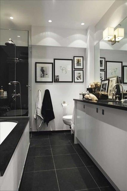 Likes: Dark floor tiles, white walls. Recessed ceiling lighting Bblack/white sink/vanity