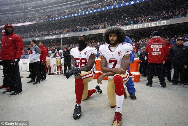 Schnatter blamed slowing sales growth at Papa John's - an NFL sponsor and advertiser - on the outcry surrounding players kneeling (Eli Harold and Colin Kaepernick are on the sideline during the anthem before the game vs Chicago Bears in December 2016)