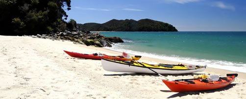 Kayaks on a beach in Abel Tasman National Park, South Island, New Zealand. #GreatFoodRace