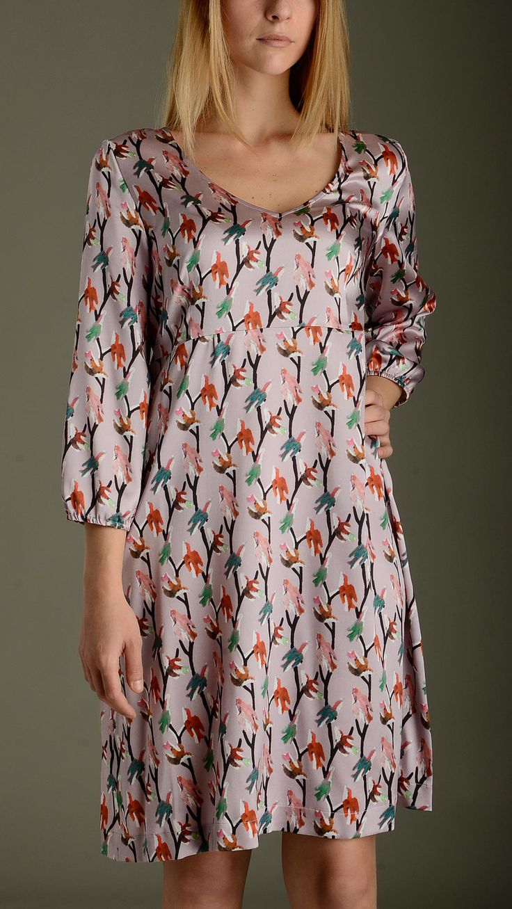 Mauve midi dress with multicolour bird pattern featuring V neckline and three-quarter bracelet sleeves with elastic cuffs, 93�0silk and 7�0elastane.