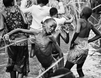 UGANDA. Rakai. 2008. James, 12, 'swimming.' - © Anna Boyiazis
