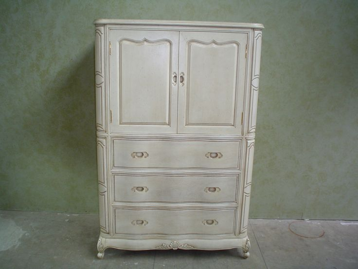 Armoire finished to an antique glazed white by AM Furniture Finishing.