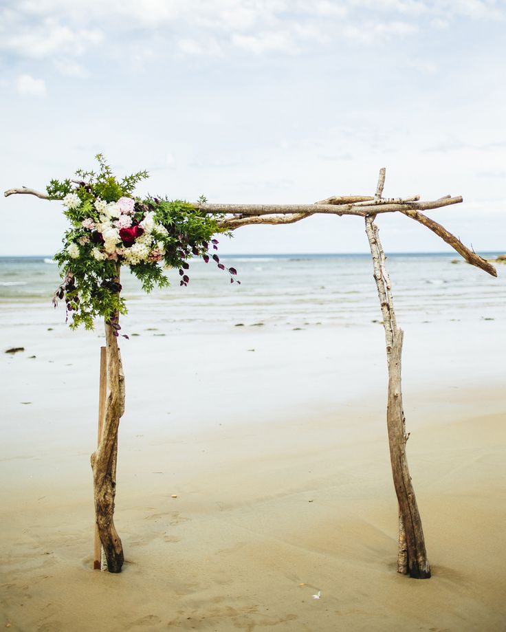Crafted from driftwood collected by the groom on surfing trip, this DIY arbour was the perfect beach wedding backdrop