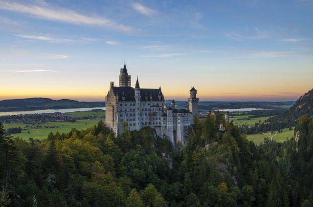 Neuschwanstein Castle at sunset Photo Credit
