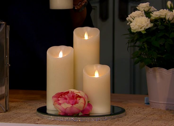 Lovely set of Luminara flameless candles made of real wax, control remote enabled and battery operated!!